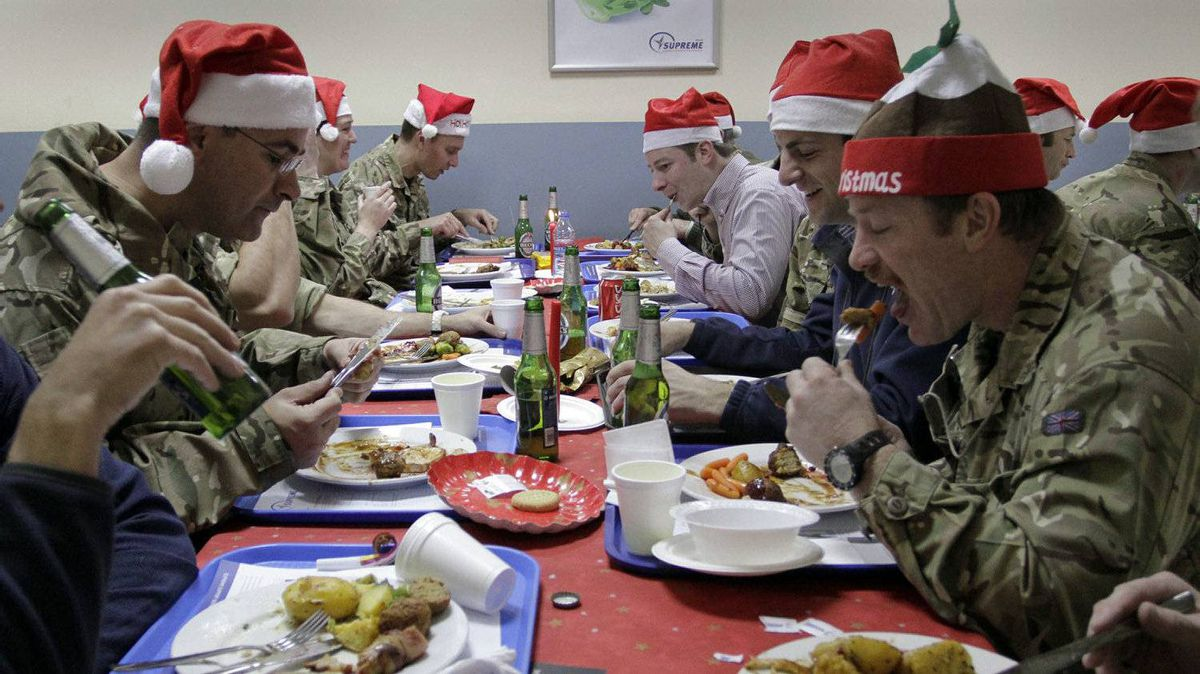Britain soldiers with the NATO- led International Security Assistance Force (ISAF) take their lunch meal on the Christmas day at the ISAF's head quarter in Kabul, Afghanistan on Sunday, Dec. 25, 2011.