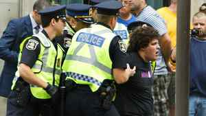 Quebec Police arrest an anti-monarchist protester before the arrival the Duke and Duchess of Cambridge at Quebec Citadelle, Sunday July 3, 2011, in Quebec city.
