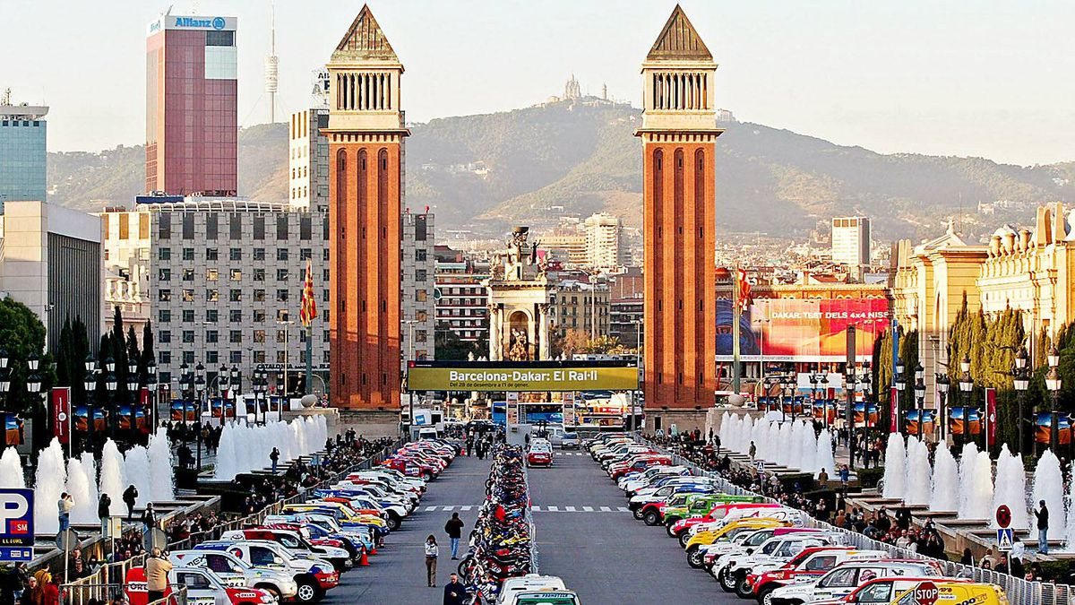 Cars and motorcycles are parked in the Avinguda de la Reina Maria Christina after the preliminary tests at Palau Sant Jordi sports in Barcelona, December 30, 2004, on the eve of the 27th Rally Dakar.