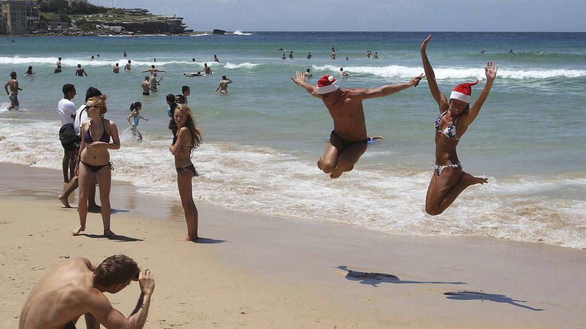 Beach goers jump in the air for a photo as they celebrate on Christmas Day at Bondi Beach in Sydney, Australia.