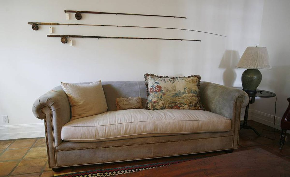 Fishing rods hang on the wall of Bernard Madoff's study in his Palm Beach, Fla. home Tuesday, Sept. 8, 2009. The house and its contents will be sold at auction.