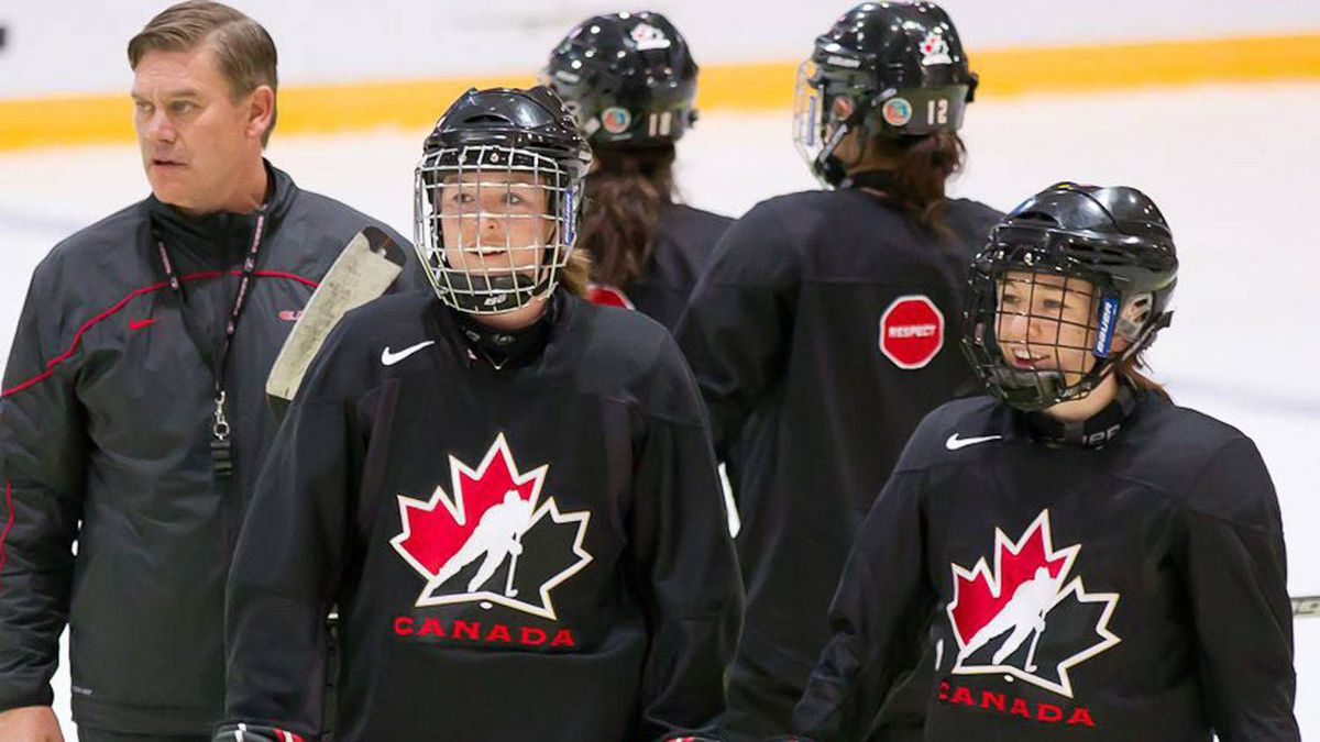 Team Canada coach Ryan Walter (left), shown at practice in Winterthur, Switzerland, Sunday, April 24, 2011, will have three defencemen play in their first world championship game Monday against the USA, including Tara Watchorn (centre) and Jocelyne Larocque (right.) THE CANADIAN PRESS/Dave Holland