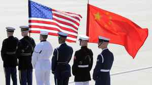 A colour guard of U.S. and Chinese flags awaits the plane of China's President Hu Jintao at Andrews Air Force Base, Maryland in this April 12, 2010 file photo. U.S. President Barack Obama unveiled a defense strategy on Jan. 5, 2012 that would expand the U.S. military presence in Asia but shrink the overall size of the force.