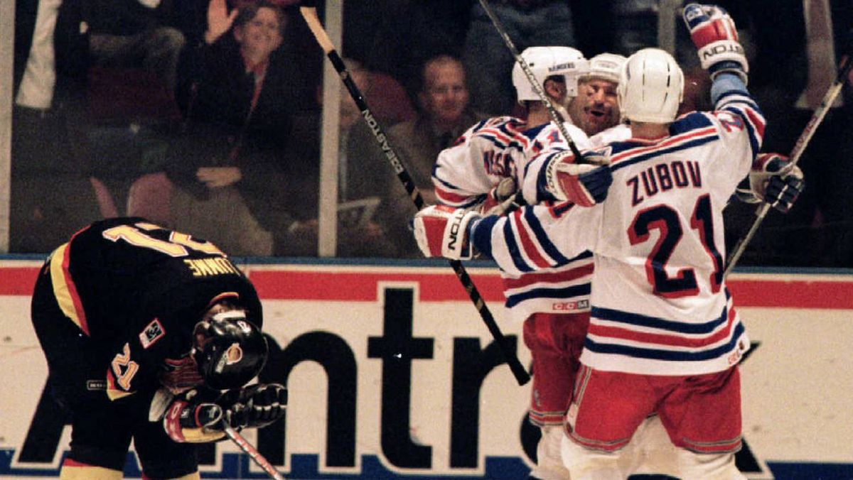 New York Rangers' Mark Messier, Glenn Anderson and Sergei Zubov celebrate Anderson's second period goal beside Vancouver Canucks' Jyrki Lumme in Game 2 of the 1994 Stanley Cup finals.