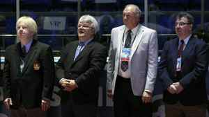 Canadian former hockey players Pat Stapleton, Marcel Dionne, Jocelyn Guevremont and Jean-Paul Parisé, left to right, stand on the ice before an exhibition game in Moscow on Feb. 25, 2012 between teams of Russian and world stars to mark the anniversary of U.S.S.R.-Canada 1972 Summit Series.