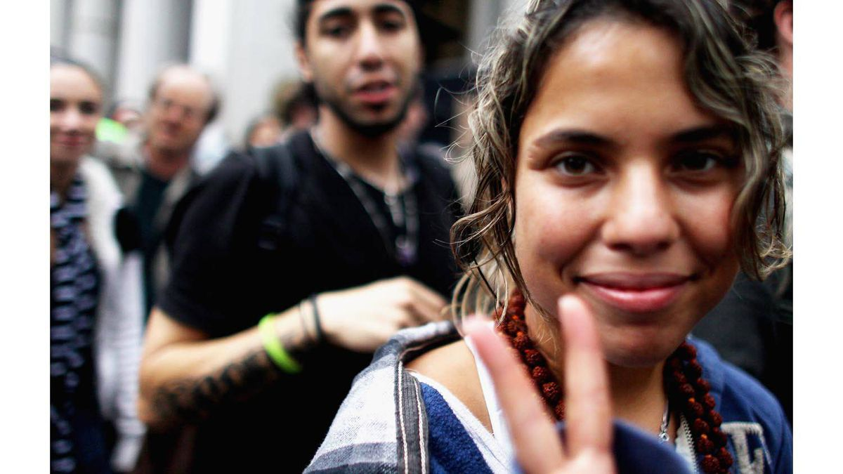 Marchers flash peace signs during the Occupy Wall Street protests in New York City on Oct. 1, 2011. Hundreds of protesters were later arrested by police.