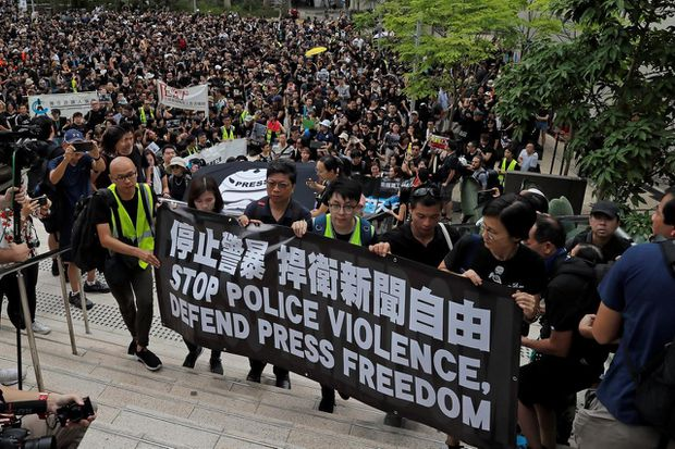 Hong Kong police, protesters clash amid expanded call for resignation of territory leader and probe into police violence
