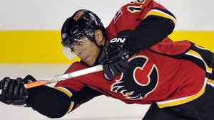 Calgary Flames captain Jarome Iginla takes a shot that scored a goal during the third period of their NHL pre-season hockey game against the Vancouver Canucks in Calgary, September 21, 2010. REUTERS/Todd Korol