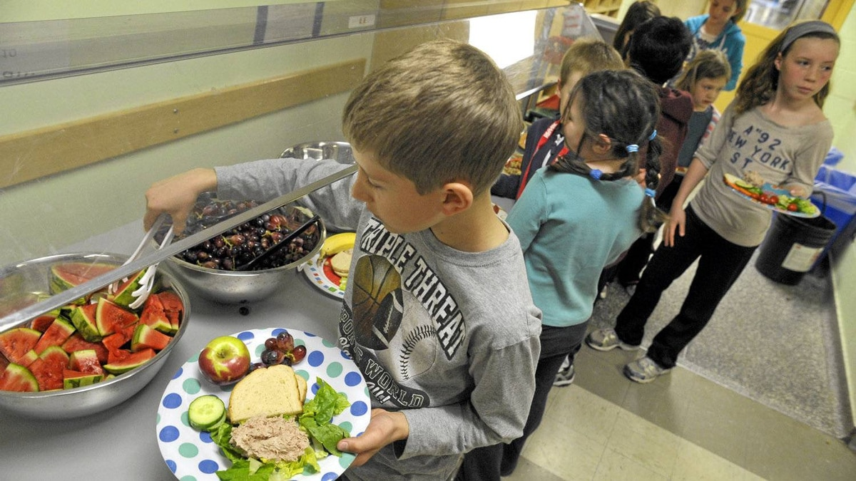 Students line up for the hot lunch program feauturing nutritious food, veggies and fruit at James S. Bell Middle School in Etobicoke, April 25, 2012. James S. Bell Middle School will be one of the new TDSB sports and wellness academies that launches in September and a few students help to prepare the food.