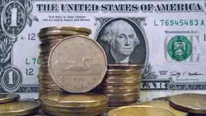 """Canadian dollars, also known as """"loonies"""" are shown with U.S dollars."""