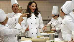 Catherine, Duchess of Cambridge, reacts during a cooking workshop at the Institut de tourisme et d'hotellerie du Quebec in Montreal July 2, 2011.