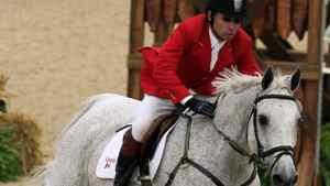 John Pearce of Canada riding Chianto competes in the speed competition of the World Jumping Championship at the World Equestrian Games in Lexington, Kentucky, October 4, 2010. REUTERS/John Sommers II
