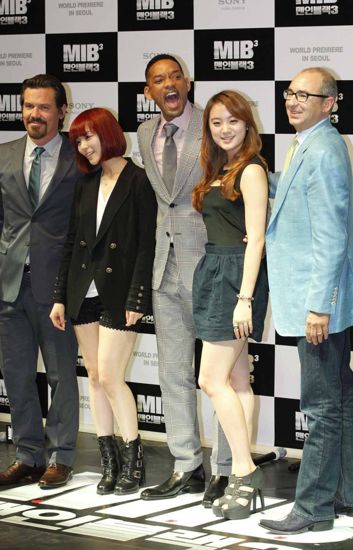 """Will Smith (centre) does this thing with his mouth at the premiere of """"Men in Black III"""" in Seoul, South Korea, on Monday."""