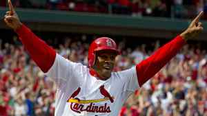 St. Louis Cardinals pinch runner Adron Chambers (56) celebrates his winning run as Chicago Cubs relief pitcher Carlos Marmol (not pictured) throws a bases loaded wild pitch at Busch Stadium. The Cardinals defeated the Cubs 2-1. Scott Rovak-US PRESSWIRE