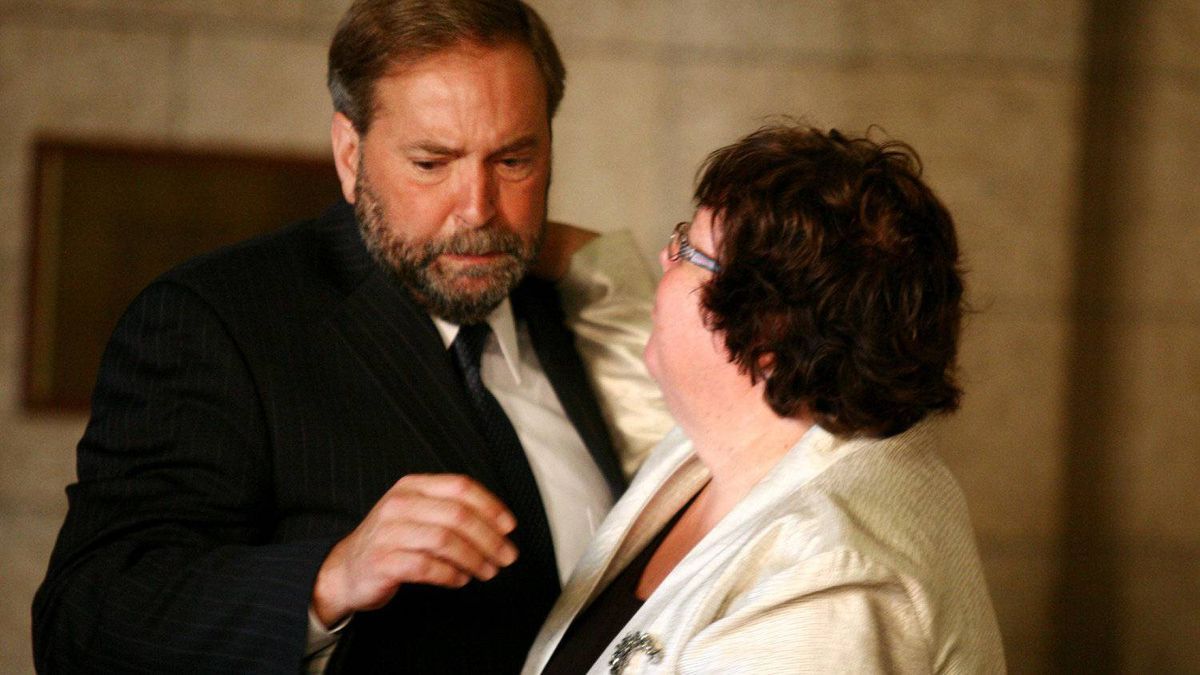 NDP MP Thomas Mulcair is comforted by fellow MP Libby Davies next to the casket of NDP leader Jack Layton on Parliament Hill.