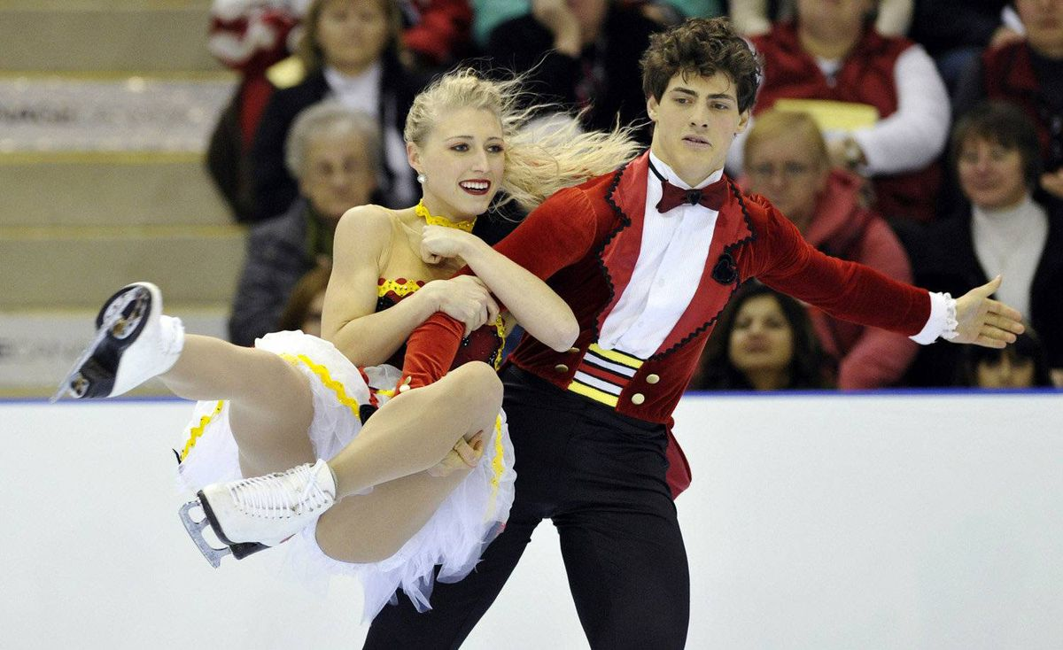 Piper Gilles and Paul Poirier skate during the dance free program at the Canadian Figure Skating Championships in Moncton, New Brunswick, January 21, 2012.