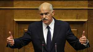 Greek Prime Minister George Papandreou delivers a speech during a parliament session on the confidence vote in Athens on November 3, 2011.