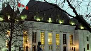 A night-time photo of the Supreme Court of Canada building in Ottawa.