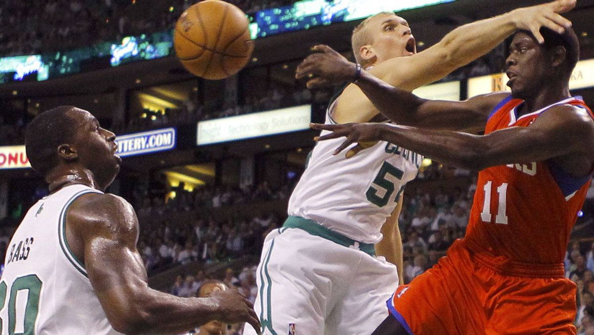 Boston Celtics' Ryan Hollins (C) battles for the ball with Philadelphia 76ers' Jrue Holiday (R) as Celtics' Brandon Bass (L) looks on during the first quarter of Game 7 of their NBA Eastern Conference playoff series in Boston, Massachusetts, May 26, 2012. REUTERS/Brian Snyder