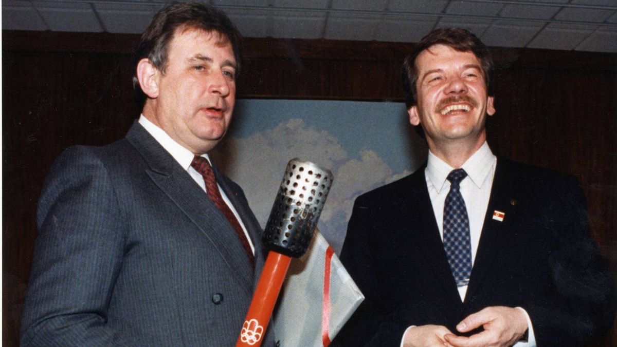 Montreal Mayor Jean Dore hands over the Montreal Olympic torch to the Calgary Mayor Ralph Klein at Calgary City Hall on Feb. 12, 1988.