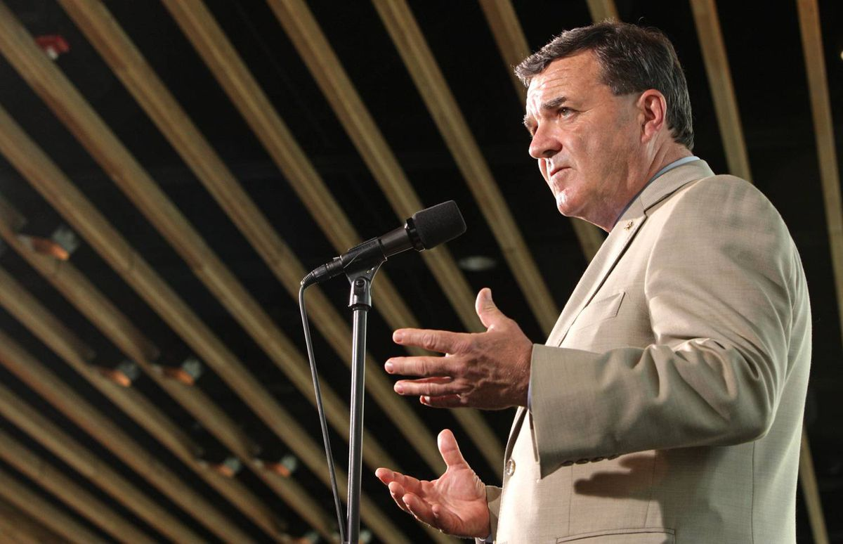 Finance Minister Jim Flaherty speaks to reporters before delivering a speech in Vancouver on Aug. 30, 2009.