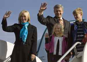 Stephen Harper, his wife Laureen, daughter Rachel and son Ben wave from the top of the stairs before boarding their plane in Calgary on Oct. 15, 2008.