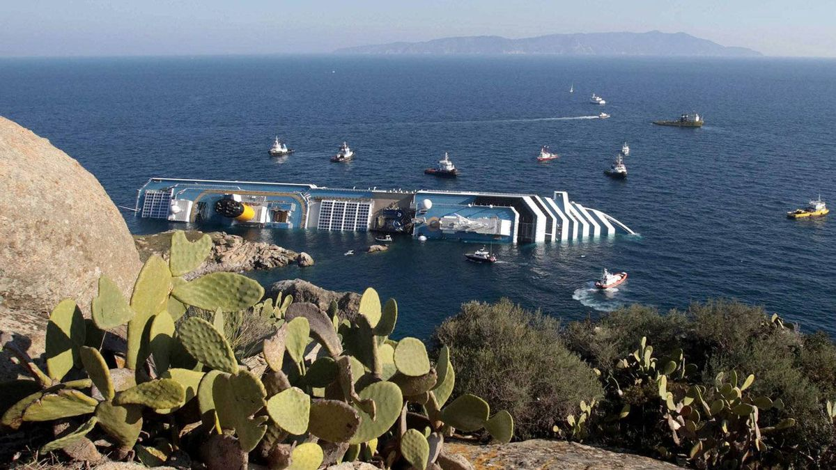 Rescue boats approach the luxury cruise ship Costa Concordia resting on its starboard side after running aground near the tiny Tuscan island of Isola del Giglio, Italy, Saturday, Jan. 14, 2012. The luxury cruise ship ran aground off the coast of Tuscany, sending water pouring in through a 160-foot (50-meter) gash in the hull and forcing the evacuation of some 4,200 people from the listing vessel early Saturday, the Italian coast guard said. In the background Italy's mainland.
