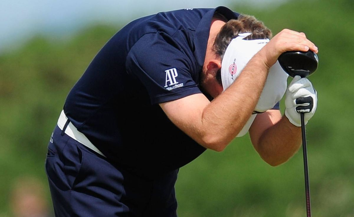 U.S. Open champion Graeme McDowell reacts to a shot during the final round of the British Open