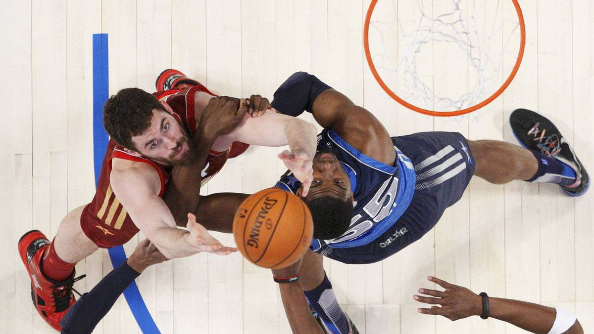 West All-Star Kevin Love of the Minnesota Timberwolves (L) battles East All-Star Joe Johnson of the Atlanta Hawks under the basket during the NBA All-Star game in Orlando, Florida, February 26, 2012. REUTERS/Jeff Haynes