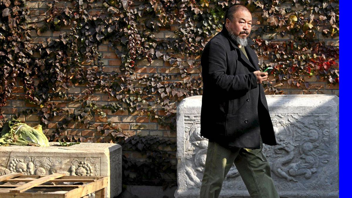 Dissident Chinese artist Ai Weiwei walks to the door of his home after talking to his lawyers in Beijing on Nov. 14, 2011.