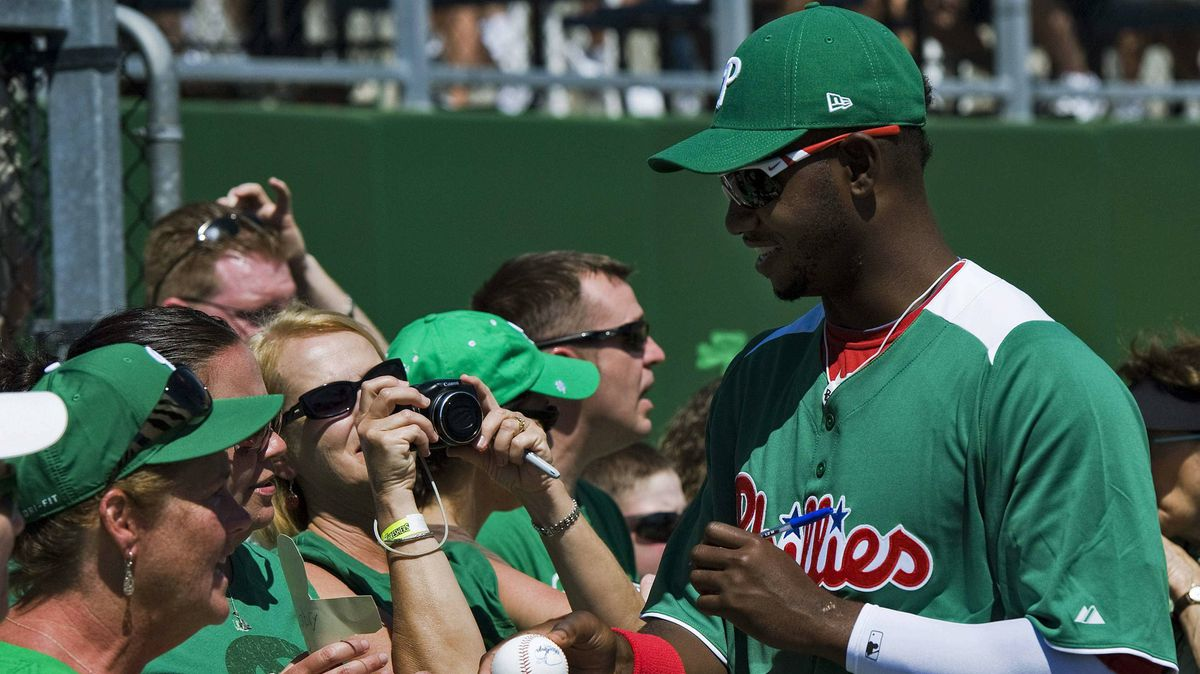 Phillies outfielder John Mayberry Jr. signs autographs before a St. Patrick's Day spring training game against the Toronto Blue Jays in Clearwater, Fla., on Saturday.