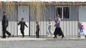 Members of the polygamous community of Bountiful gather for church Sunday, April 20, 2008 near Creston, B.C.