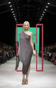 Laing's trademark geometric shapes once again reigned supreme, ranging from a swoop sleeve asymmetrical dress, to an apron halter and a belted kimono vest.