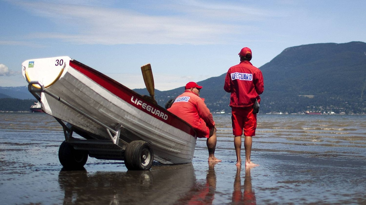 Lifeguards at Locarno Beach in Vancouver, British Columbia, Monday July 4, 2011.