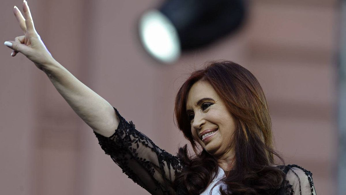 Argentina's reelected President Cristina Fernandez de Kirchner flashes the V sign during her inauguration ceremony, in Mayo square, Buenos Aires on December 10, 2011.