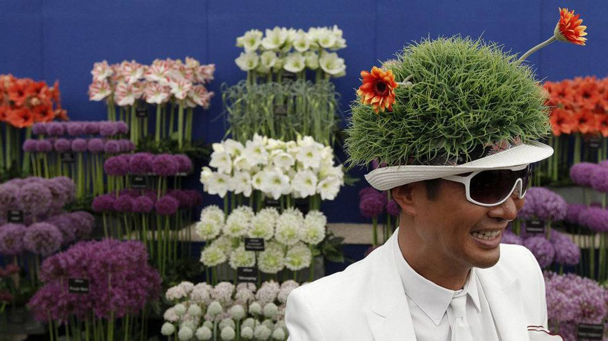 Hong Kong businessman William Louey shows off his floral hat during media day at the Chelsea Flower Show 2011, London May 23, 2011.