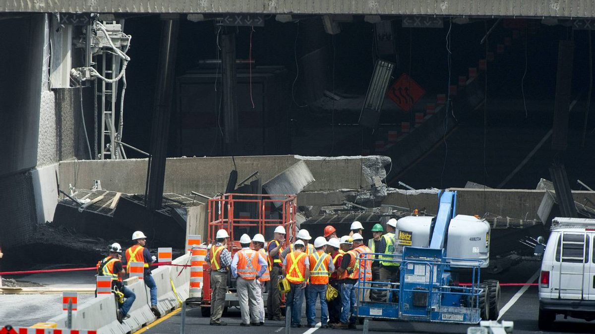 Engineers inspect a concrete slab that fell on a major expressway Monday, August 1, 2011 in Montreal. No one was injured in the collapse on Sunday, the latest in a series of incidents that point to the city's crumbling infrastructure.