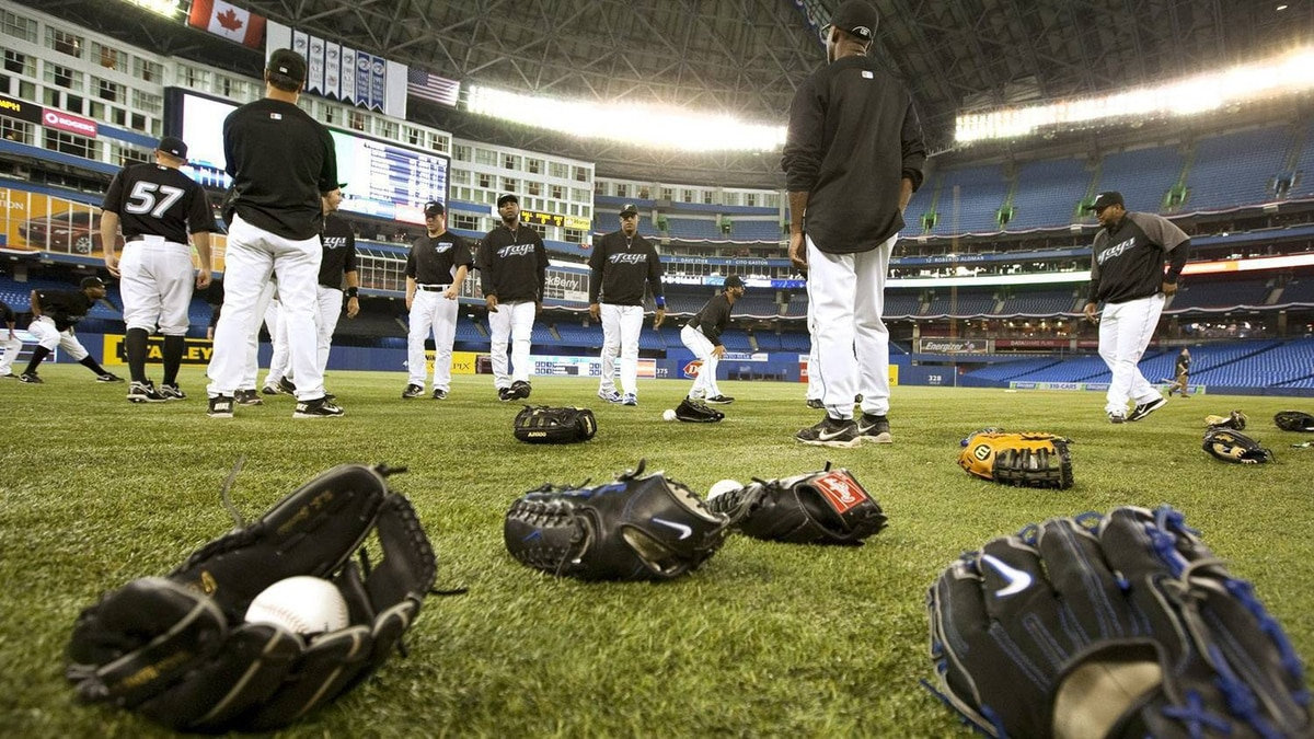 Baseball gloves litter the field as the Toronto Blue Jays participate in the team's first workout at the Roger Centre in Toronto Thursday, 31, 2011. The Blue Jays open up their 2011 season against the Minnesota Twins at the Rogers Centre Friday, April 1. THE CANADIAN PRESS/Darren Calabrese