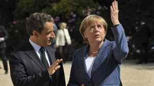 France's President Nicolas Sarkozy welcomes German Chancellor Angela Merkel as she arrives for a meeting at the Elysee Palace in Paris, August 16, 2011.