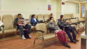 People wait to see a doctor in the Emergency/Trauma Unit waiting area at Sunnybrook Hospital on December 5, 2010.