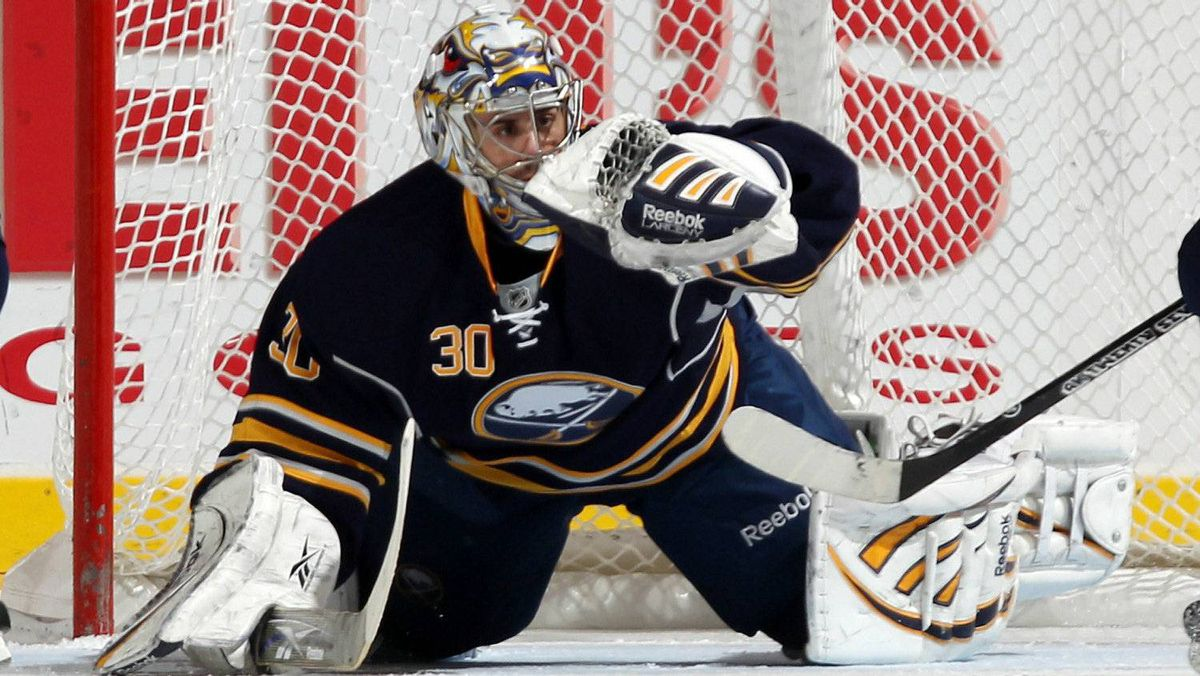Ryan Miller of the Buffalo Sabres makes the save against the New York Islanders at the Nassau Coliseum on January 23, 2011 in Uniondale, New York.