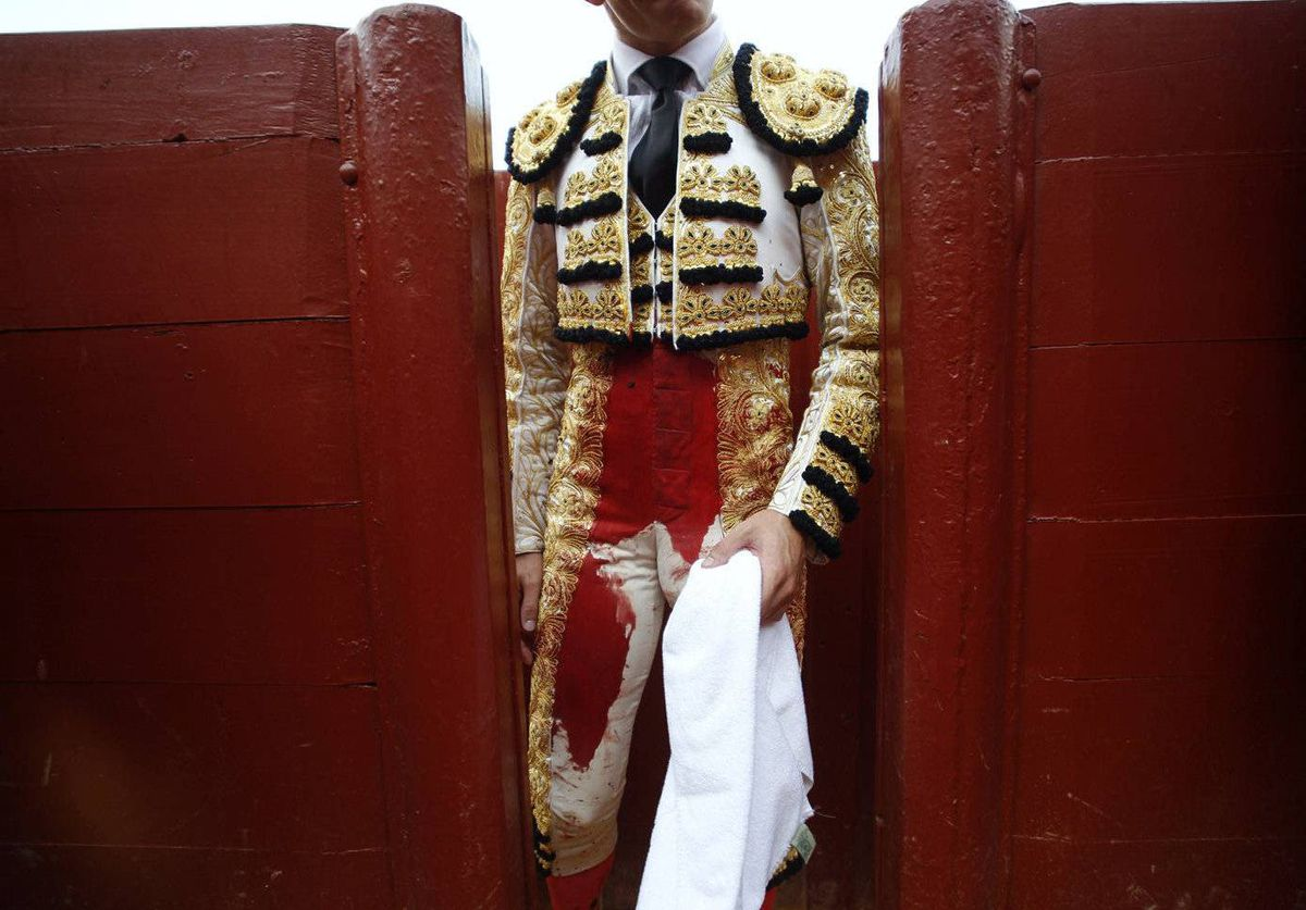 Spanish matador Daniel Luque is seen after killing a bull during a bullfight in The Maestranza bullring in Seville .