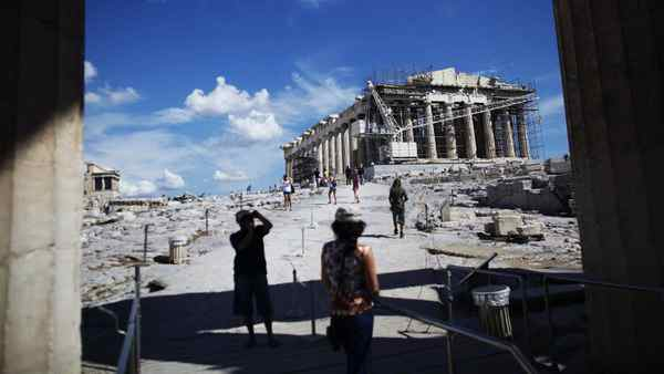 Tourists visit the Parthenon temple ruins in Athens, Greece, on Wednesday, Sept. 21, 2011.