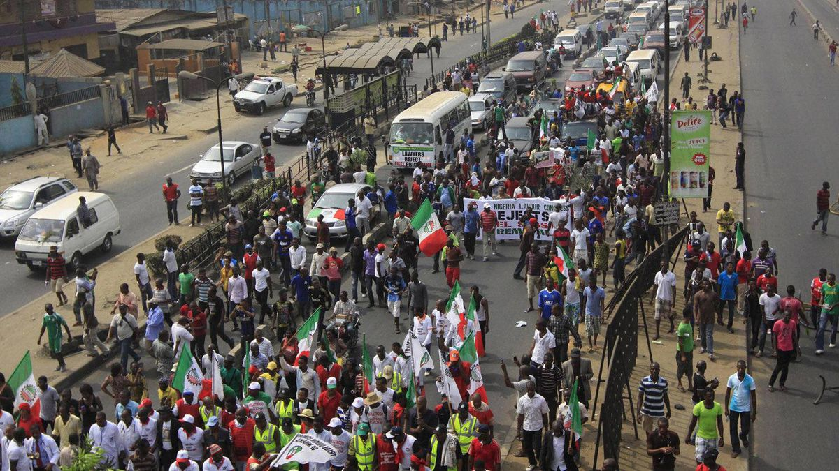 People protest following the removal of fuel subsidy by the government in Lagos ,Nigeria, Monday, Jan. 9, 2012. A national strike paralyzed much of Nigeria on Monday, with more than 10,000 demonstrators swarming its commercial capital to protest soaring fuel prices and decades of government corruption in the oil-rich country.