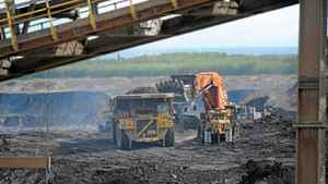 Heavy machinery operates in the pit at the Shell Albian Sands located in Alberta's oil sands north of Fort McMurray, Alta, Aug. 31, 2010.