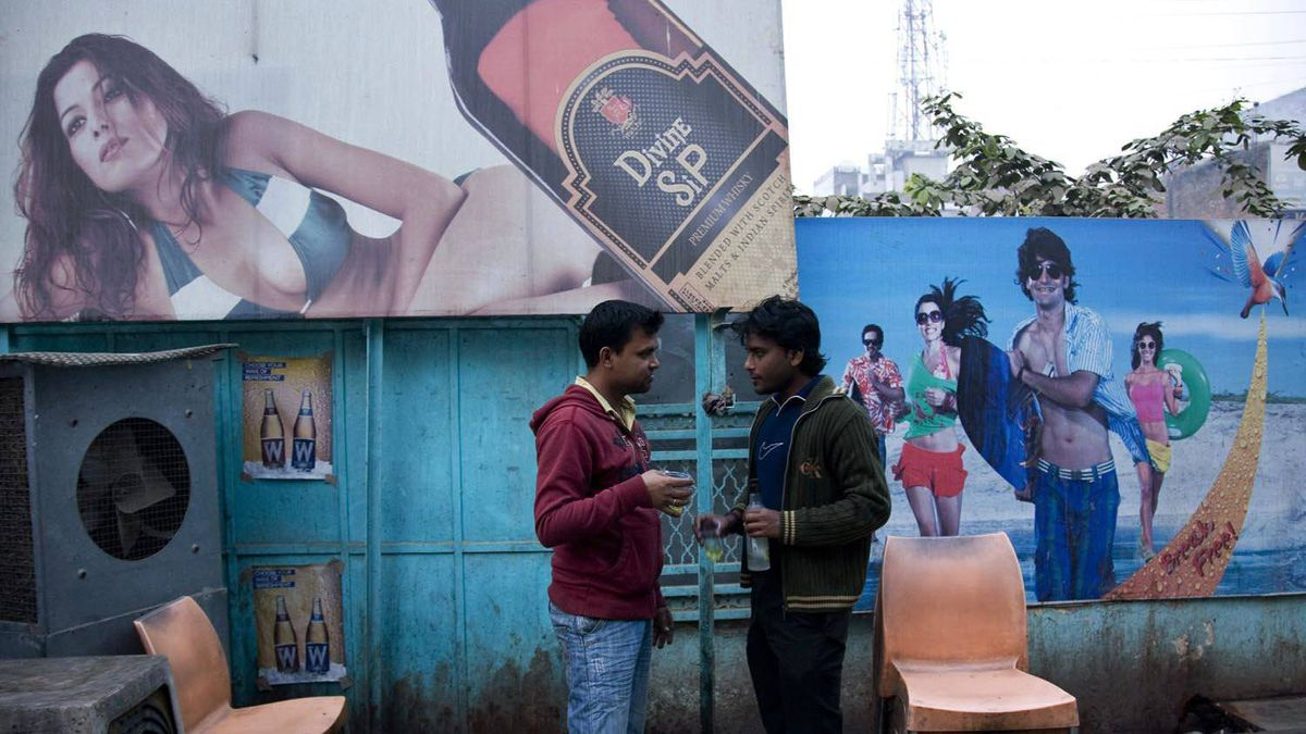 Two Indian men drink outside a state-sanctioned liquor shop in Allahabad, India, on Dec. 15, 2011. Two-thirds of the alcohol consumed in the country is illegal hooch made in remote villages or undocumented liquor smuggled in, according to The Lancet medical journal.