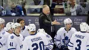 Toronto Maple Leafs head coach Randy Carlyle talks with players during second period action against the Montreal Canadiens in Montreal, March 3, 2012.