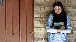 Third year student Aisha Raja poses for a photo at the University of Toronto on June 30, 2011. Raja who has been Muslim her whole life, is involved with promoting 'Keeping it Halal', a campus internet publication which she hopes will help break Muslim stereotypes. She has been wearing an hijab since high school and feels it is part of her.