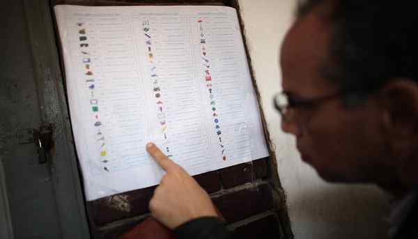 A voter studies a ballot paper at a polling station in Garden City on November 28, 2011 in Cairo, Egypt.