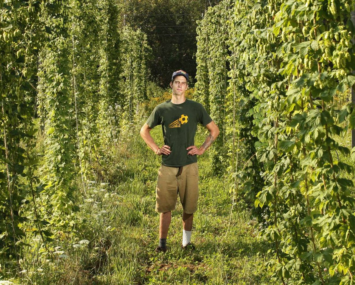 Joshua Herbin has won an innovation award for his work growing hops. But the 24-year-old still relies on outside work – milking cows on a nearby dairy farm and growing vegetables – to pay the bills.